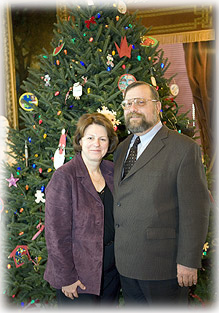 Tom and Sue in front of tree presented to Gov. and Mrs. Doyle December 2005.