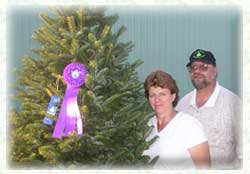 Tom and Sue with 2004 WI Grand Champion Tree