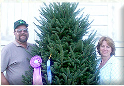 Tom and Sue with 2005 WI Grand Champion Tree