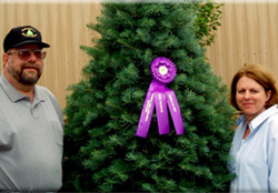 Tom and Sue with 2007 WI Grand Champion Tree