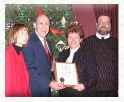 Presenting tree to Gov. & Mrs. Jim Doyle Dec. 2003